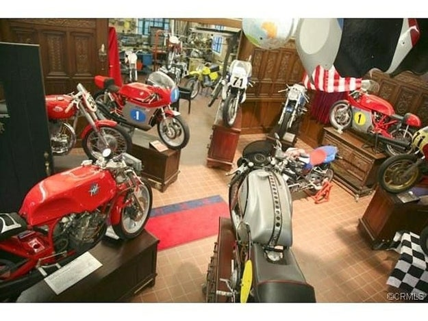 A classic car and motorcycle restoration and display area offers floor space for up to six cars and 30 motorcycles.