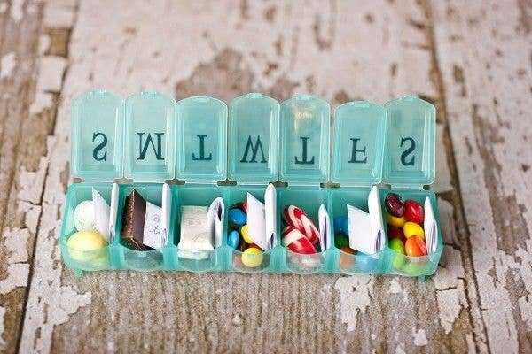 Fill a pill case with candy and love notes for a daily treat.