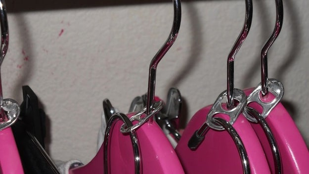Instead of dropping cash on space-saving hangers, save soda tabs and use them to fit twice the amount of hangers in your closet.