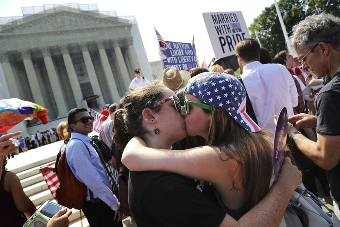 Sarah Beth Alcabes, left, kisses girlfriend Meghan Cleary, both of California, after the U.S. Supreme Court's rulings in cases against the federal Defense of Marriage Act and California's Proposition 8, outside the court in Washington, June 26, 2013.