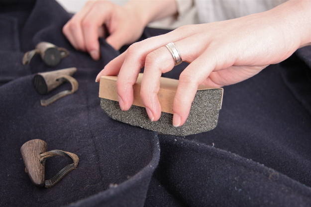 Use a pumice stone to de-fuzz a sweater.