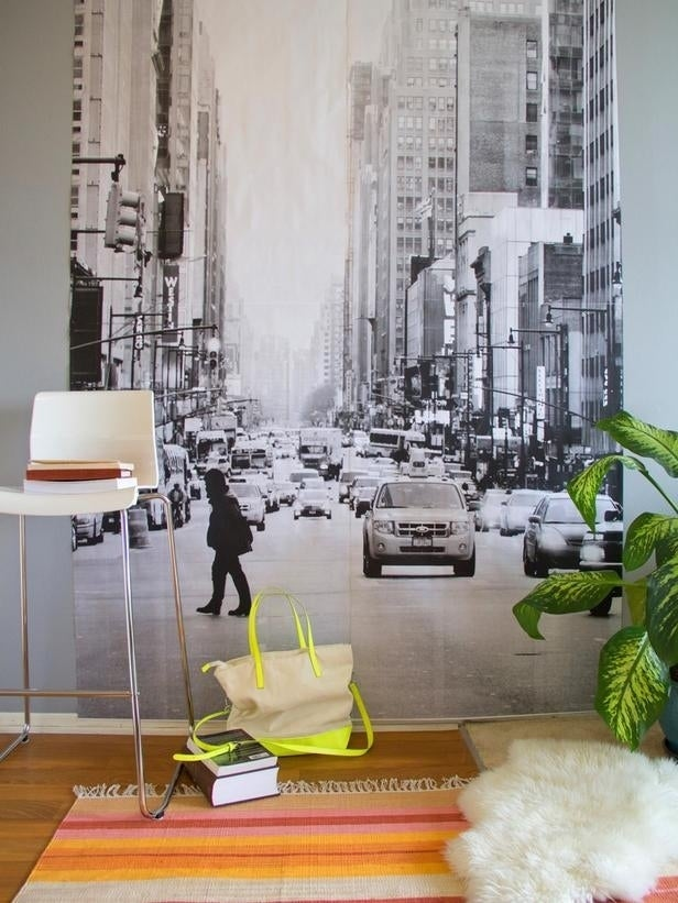 A printable wall mural makes your room feel much larger without the permanence (or cost) of paint or wallpaper.Instructions here.