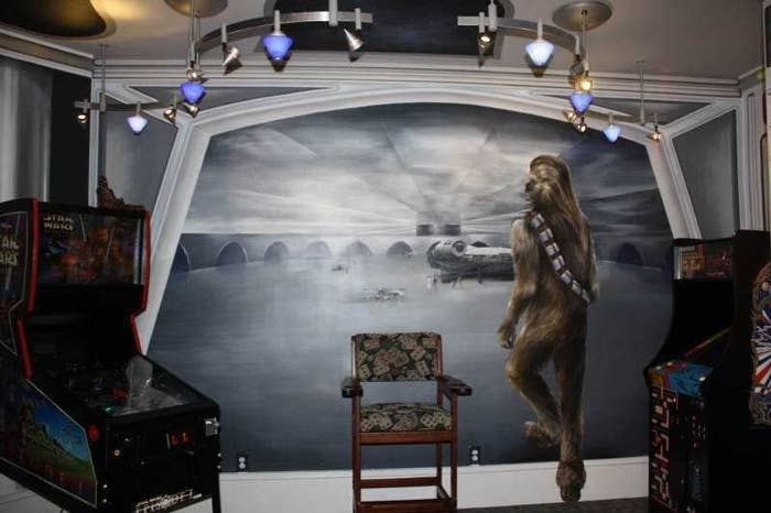 """You've reached ultimate """"Star Wars"""" geek status when your collection has been lent out to the father of """"Star Wars"""" — George Lucas. This Indiana home includes a top-to-bottom themed bar, complete with full-size figurines and a mural so lifelike it would confuse Obi-Wan."""
