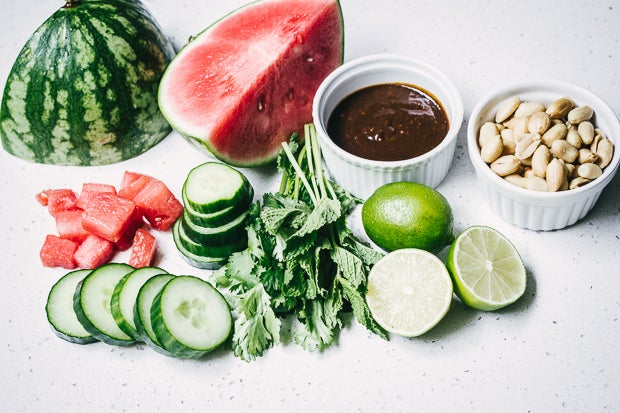 Watermelon, cucumber, limes, mint, cilantro (if you want), hoisin sauce, and peanuts. Get the full recipe from Epicurious via Bon Appetit.