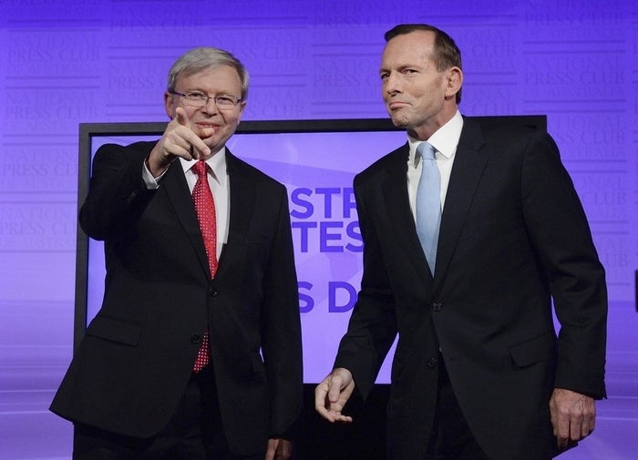 Australia's Prime Minister Kevin Rudd (left) and opposition leader Tony Abbott pose during the Leaders Debate, ahead of the Sept. 7, election, at the National Press Club in Canberra on Sunday, Aug. 11, 2013.