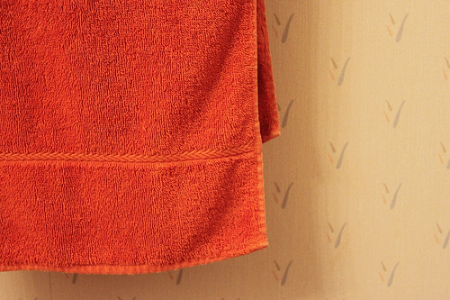 When it's hot out, hang a damp towel hung over an open window to cool down a stuffy dorm room.