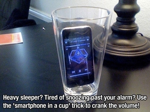 If you're a heavy sleeper, putting your phone into a glass will amplify the sound.