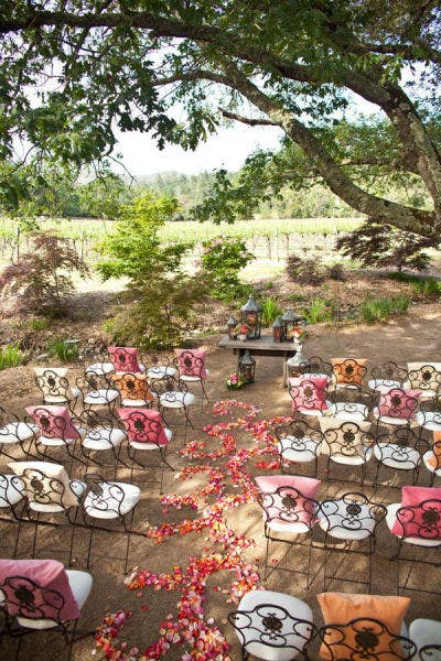 Many outdoor seats are wrought iron or wood, which can get uncomfortable if you're sitting on them for long periods of time. The pillows also add an extra decorative touch.