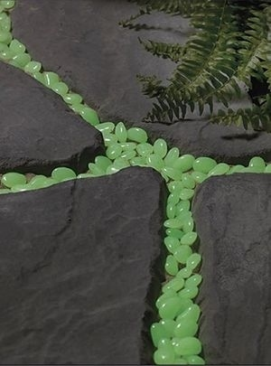 Spray paint pebbles with glow-in-the-dark paint to light a path at night.