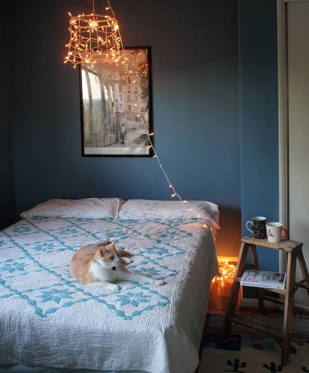 that way you can either skip the bedside table or keep your table space free - Tiny Bedroom