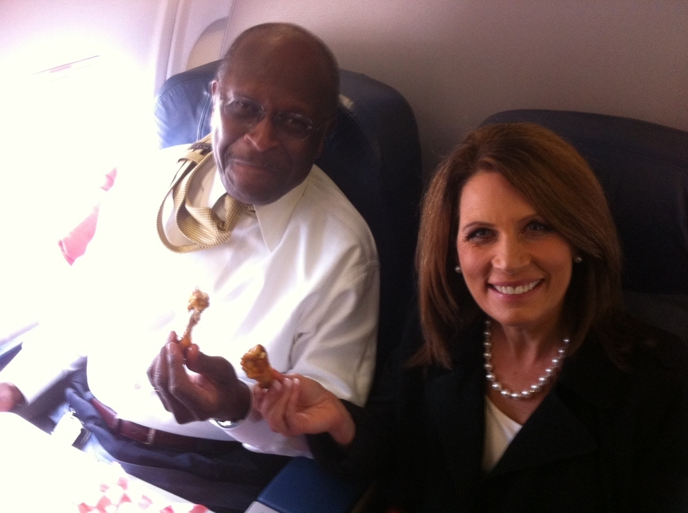 Herman Cain And Michele Bachmann Eat Chicken Wings