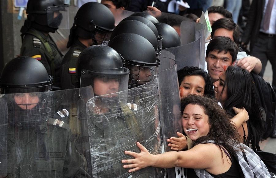 Protestors Hug Riot Policemen