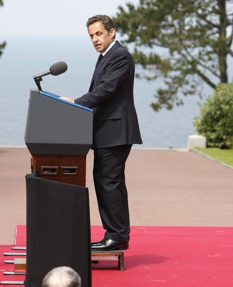 Sarkozy Uses Platform to Appear Taller Behind Podium