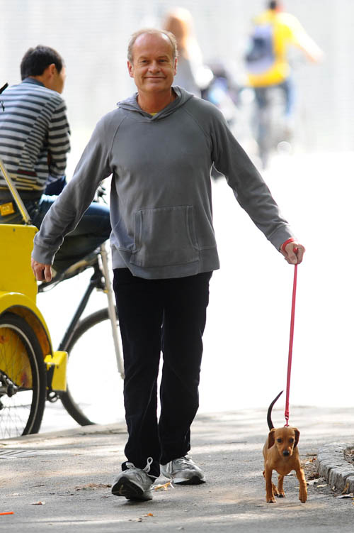 Kelsey Grammer Walking a Tiny Dog