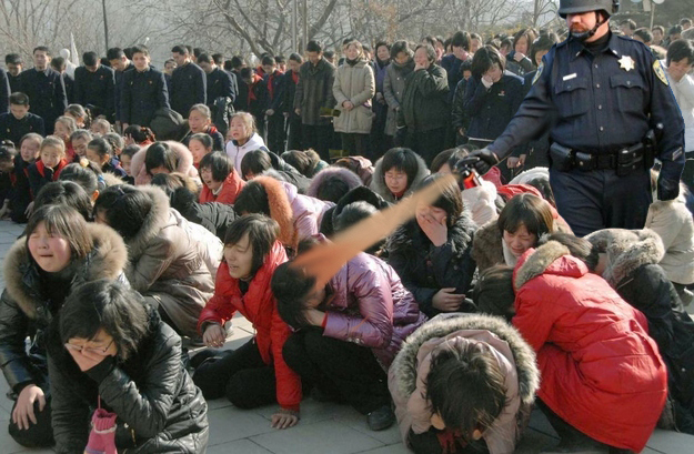 Pepper Spray Cop Hits North Korea