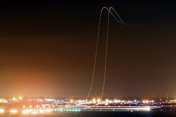 Long Exposure Of An Airplaine Takeoff