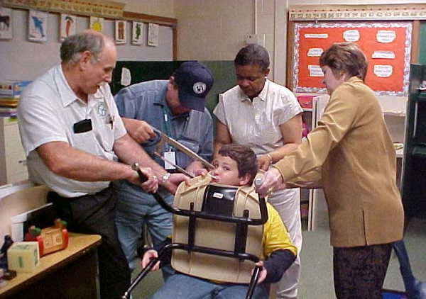 Elementary School: Stuck Kid Cut From Chair With Hack Saw!