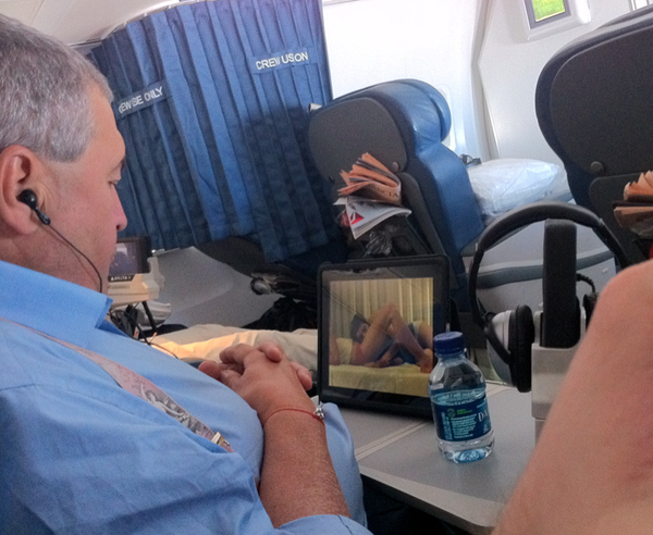 Fat Guy Watching Porn On Airline (Slightly NSFW)