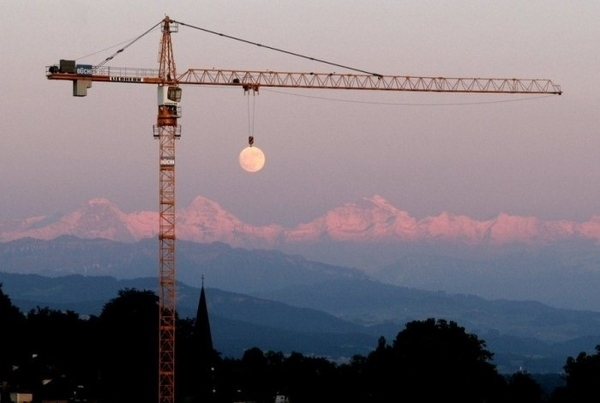 Crane Lifts Moon