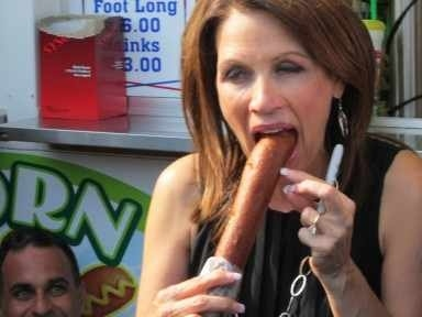 Michele Bachmann Eats A Corndog At Iowa State Fair