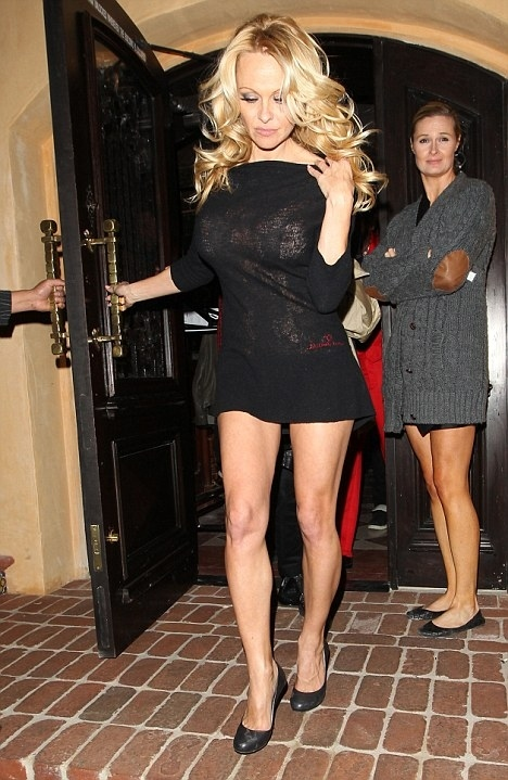 Pamela Anderson is Caught Out As She Goes Braless in a Transparent Dress