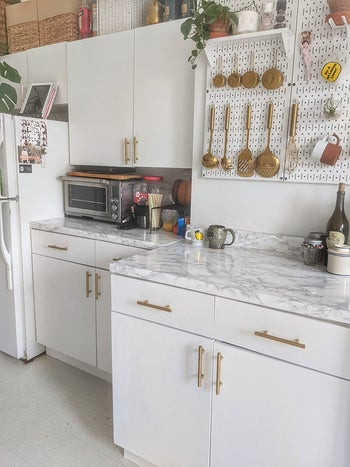 reviewer's kitchen countertops covered in the paper