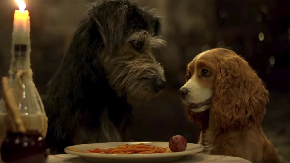 Lady and the Tramp sit in front of a plate of spaghetti and meatballs