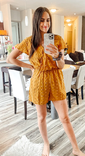 a different reviewer wearing the jumpsuit in mustard