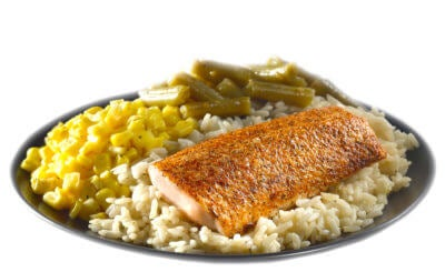 Grilled salmon over rice with corn and green beans