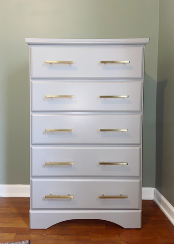 reviewer's white dresser with the gold drawer pulls on it