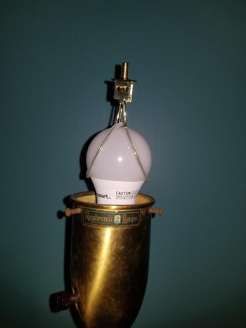 The adapter, which sits on top of the light bulb