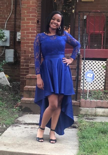 another reviewer wearing the lace sleeve and bodice dress in blue