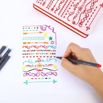 hand colors in journal with red pen