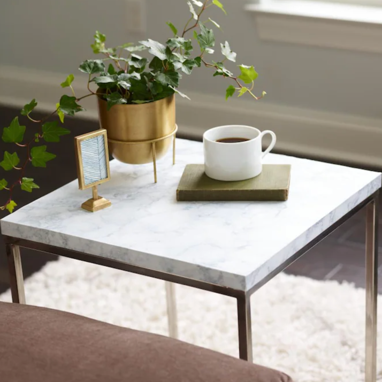 side table covered in the marble contact paper