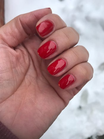another reviewer with a red shiny manicure