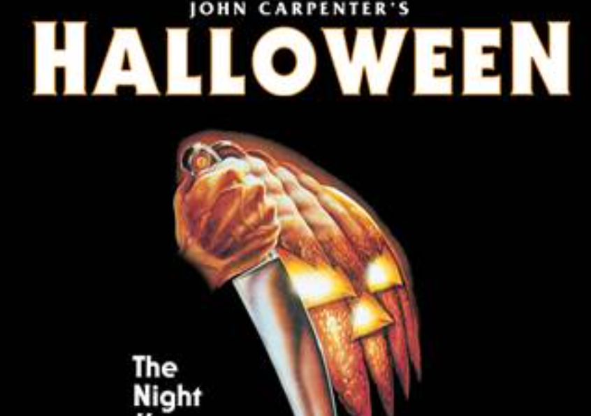 Poster for Halloween which shows a pumpkin with spiked teeth holding a knife