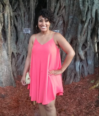 reviewer wearing the pink dress