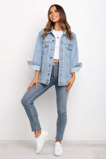 front view of a model in the light blue denim jacket