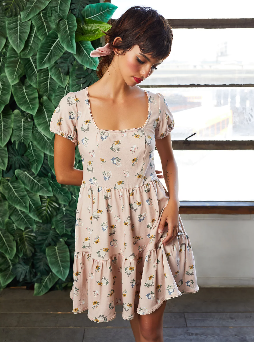 aa model in a pale pink t-shirt dress covered in a totoro design
