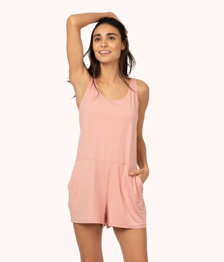 model wearing the scoop-neck romper in light pink