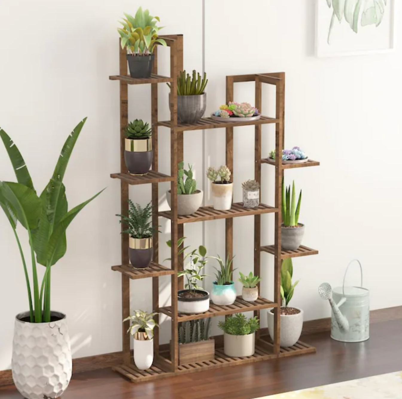 plant stand styled with multiple plants of various sizes