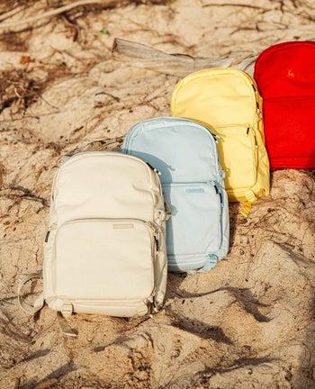 four backpacks lying on rocks