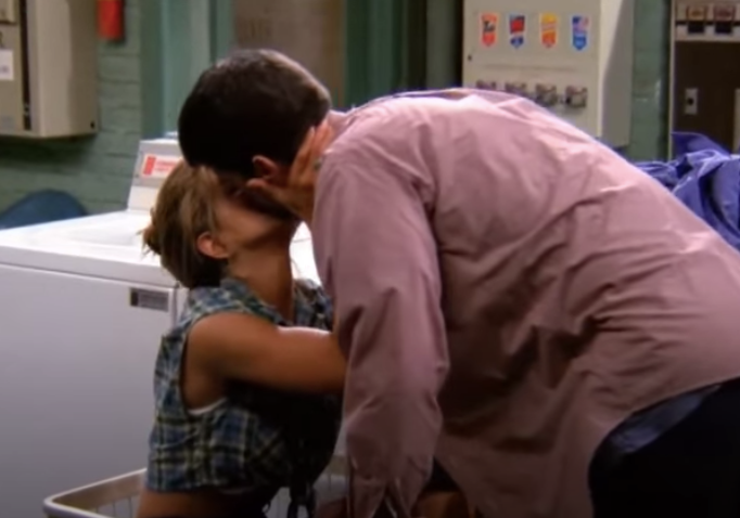 Ross and Rachel kiss in a laundromat