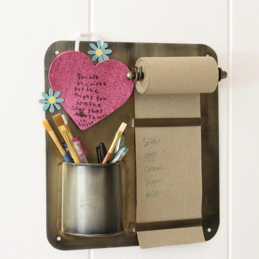The brass plate with paper note roll and pen cup