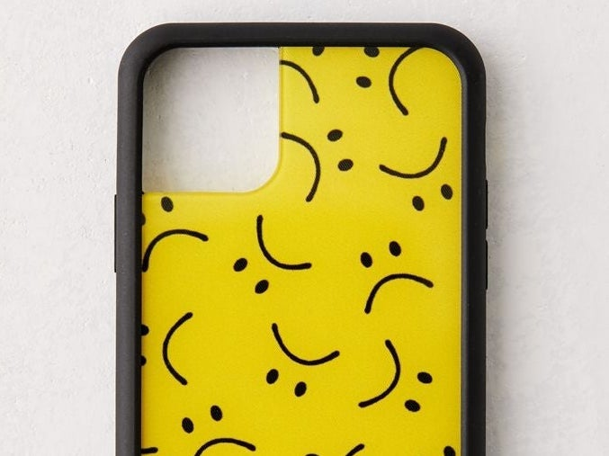 A phone case with sad faces on it