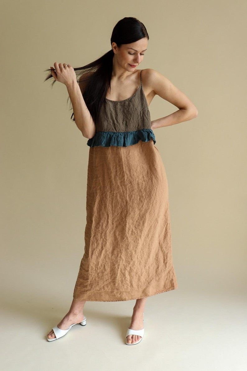 model in the dark brown, teal, and tan colorblocked slip with ruffle at waist