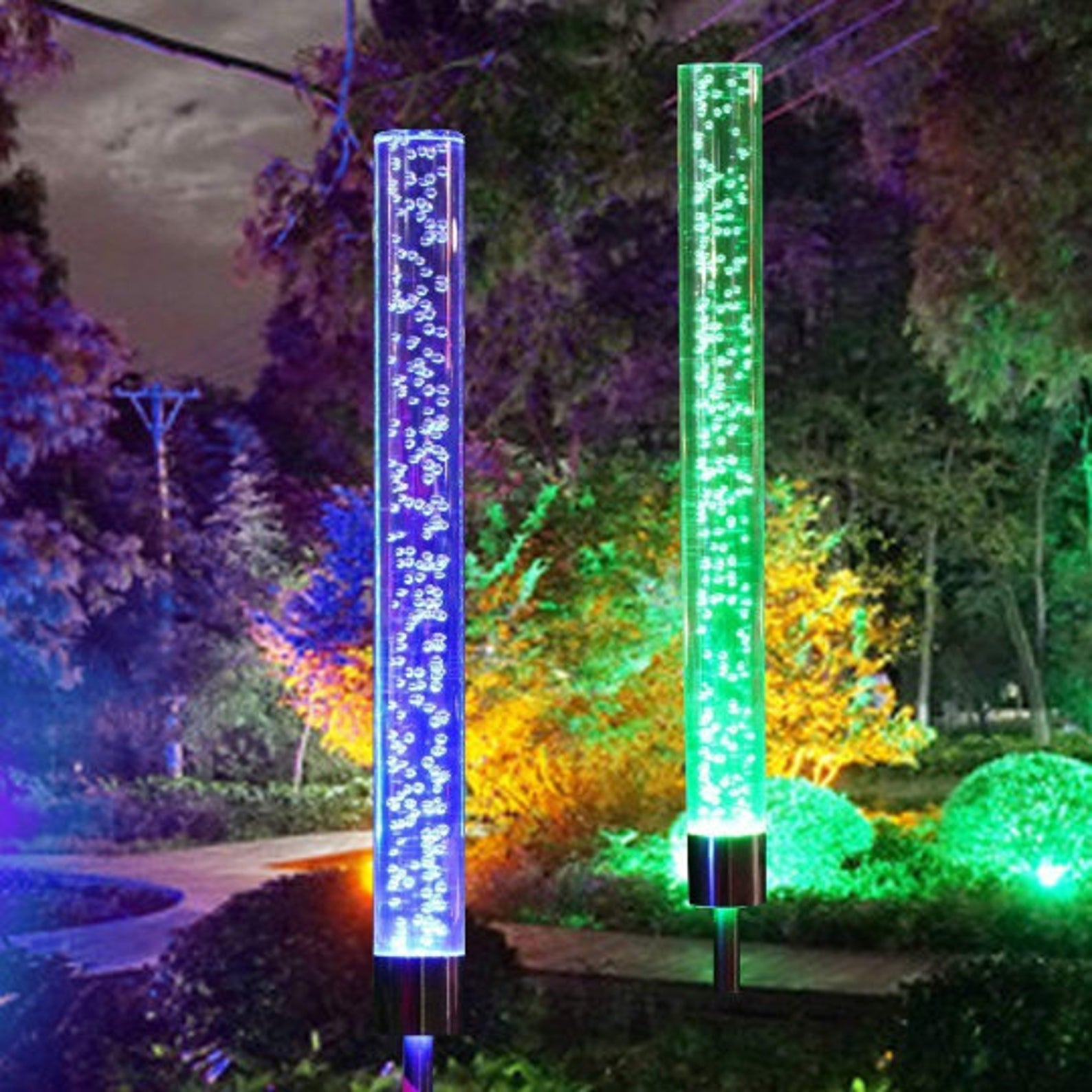 Solar powered bubble lights in different colors lighting up a pathway