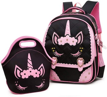 the backpack in lunch bag in black with pink designs on it