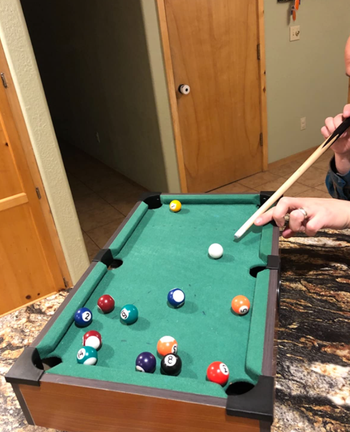 a reviewer playing pool