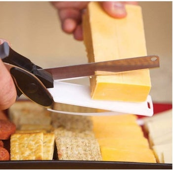 Model using it to cut a block of cheese